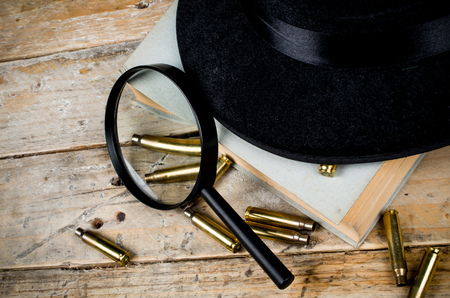 fedora: Fedora hat, bullets and magnifying glass, a film noir concept