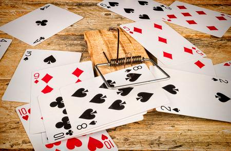 Cards inside a mousetrap, a gambling addiction concept Stock Photo