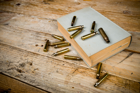killings: Still life  with old book and bullets, a mystery novel concept