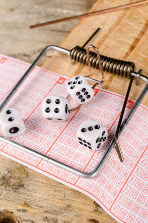 compulsive: Dice and lottery ticket in a mousetrap, a concept Stock Photo