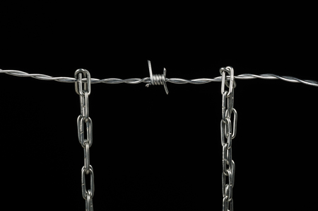 barb wire isolated: Barbed wire and chain, a human rights and immigration concept