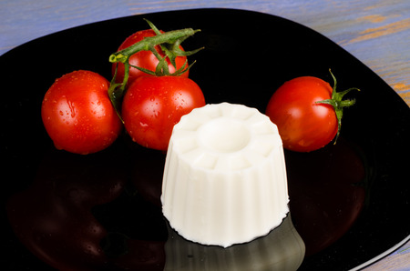 Fresh cheese and tomatoes, Mediterranean food staples Stock Photo