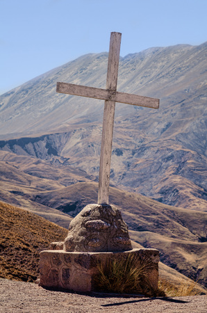 argentinean: Cross marking a summit  on a hiking trail in the Argentinean highlands Stock Photo