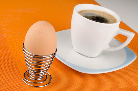 hard boiled: Hard boiled breakfast egg with a cup of coffee