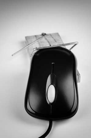 business metaphore: Computer mouse in a trap, a  e commerce and computer addiction concept