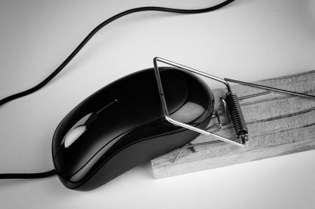 e commerce: Computer mouse in a trap, a  e commerce and computer addiction concept