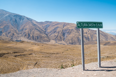 stating: Sign stating high altitude on an Argentinian Andean pass