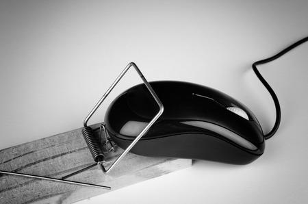 Computer mouse in a trap, a  e commerce and computer addiction concept