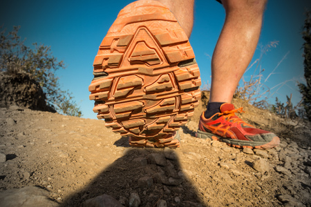 Low angle viewpoint take of the soles of a cross country runner