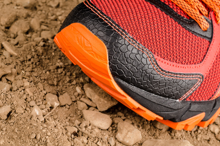 cross country: Trainers on rough  unpaved ground during cross country running