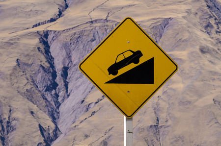 steep: Sign warning of a steep descent on an Andean road