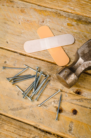 bandaid: Hammer nails and band aid, a domestic DIY accident concept