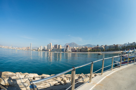 tourist resort: Sunny summer day on Benidorm beach,  Spains major tourist resort