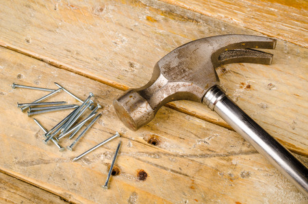 hammer and nails: Hammer nails and band aid, a domestic DIY accident concept