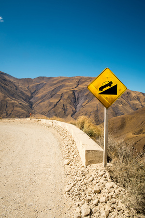 Warning signs on a steep road crossing an Andean moutain pass in Salta, Argentina