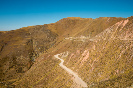 Andean dirt road winding high up in Salta province, Argentina