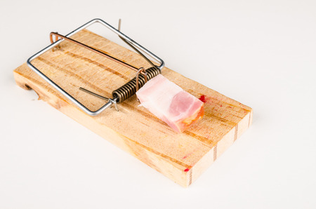 Mousetrap with bacon, a conceptual shot on nutrition.