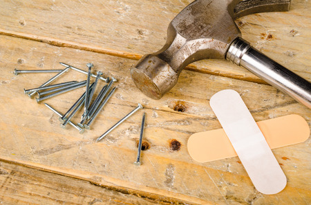 hammer and nails: Hammer nails and bandage, a domestic DIY accident concept