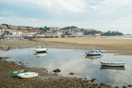 San Vicente de la Barquera traditional fishing harbor at low tide, Santander, Spain