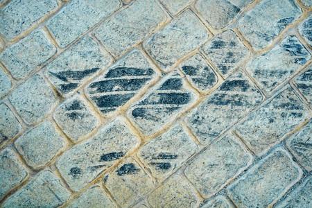 tire marks: Fesh tire marks on a cobblestone street