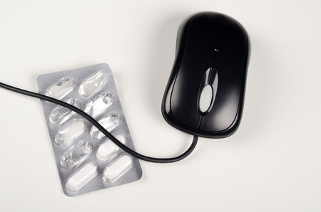suicidal: Pill blister and mouse, a concept of self medication and  medicine abuse Stock Photo