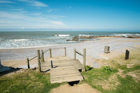 Wooden walkway leading to sandy La Paloma beach, Uruguay, South America