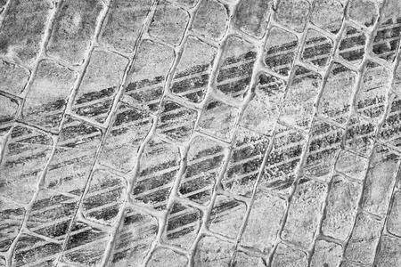 tire marks: Fresh tire marks on a cobblestone street