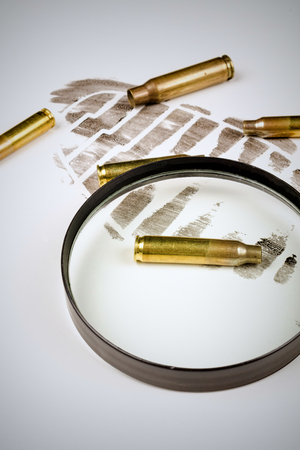 Footprint and bullet shells  on a crime scene, a concept