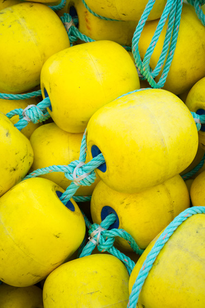 buoys: Full frame take of industrial fishing boat buoys.