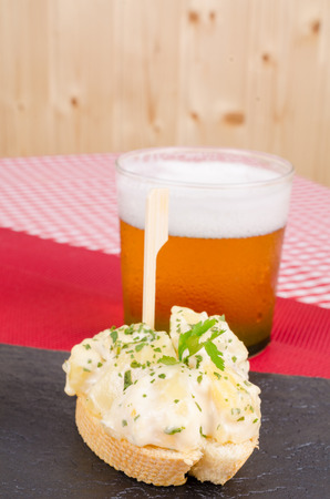 andalusian cuisine: Pincho tapas, a slice of bread with an appetizer skewered on top, a Spanish cuisine  classic