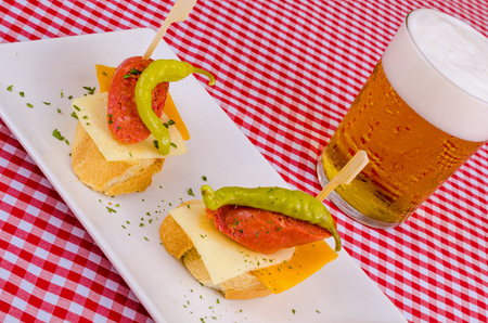 andalusian cuisine: Chorizo and cheese tapa with a hot guindilla pepper topping