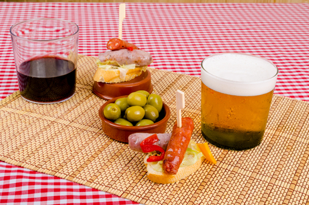 andalusian cuisine: Pincho style chorizo tapa served with a drink