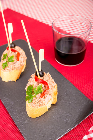 andalusian cuisine: Tapa in pincho style, slice of bread with tuna and a vegetable garnish