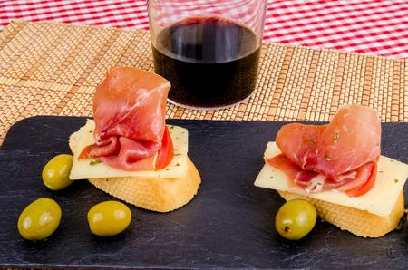 serrano: Traditional Spanish pincho style serrano ham  tapa Stock Photo