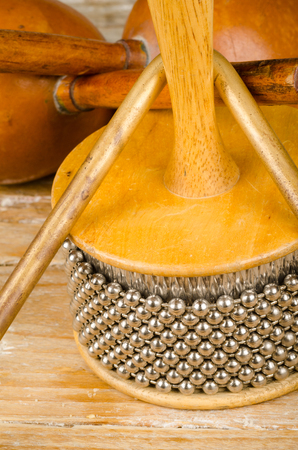 Assorted traditional small percussion instruments on a wooden background