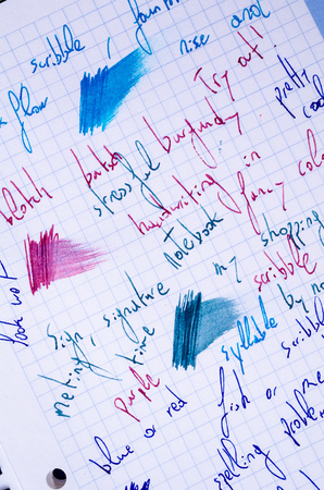 smeared: Handwritten scribbling in different fountain ink colours and line variations on a notebook page Stock Photo