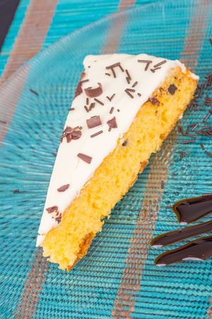 chocolate sprinkles: Homemade glazed cake wedge decorated with chocolate sprinkles