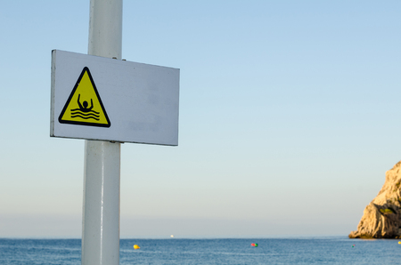 currents: Sign on a beach resort warning of strong rip currents