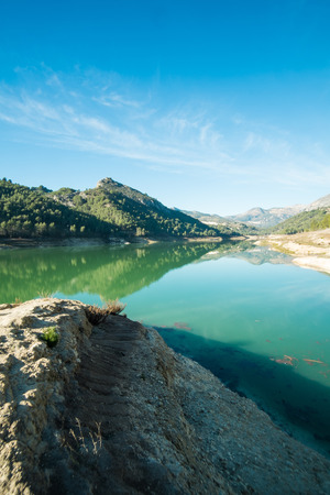 blanca: A sunny winter day on the shores of Guadalest reservoir, Costa Blanca,Alicante, Spain