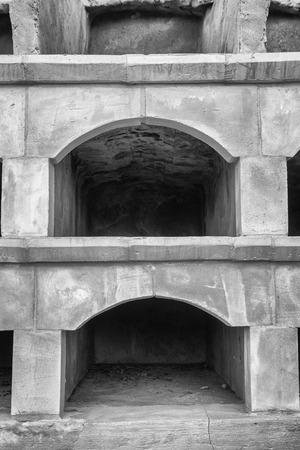 niches: Old empty stone niches on at cemetry Stock Photo
