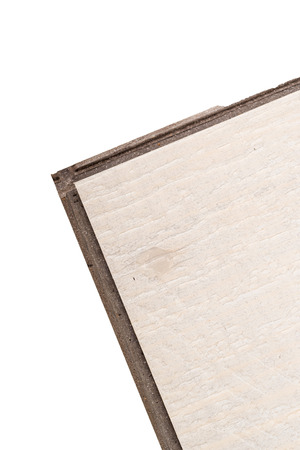 floor covering: Detail take of a vinyl floating flooring tile whit its lip and grooves to click into each other