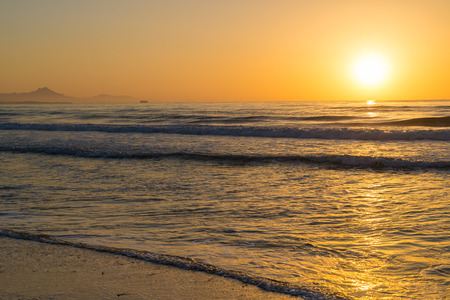 Sunrise on a Mediterranean beach on Costa Blanca, Spain