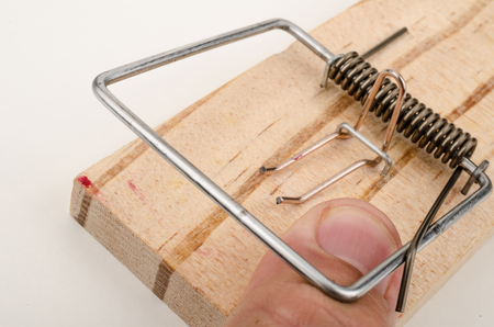 pinched: Finger caught by a mousetrap, a conceptual shot