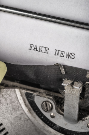 accusations: Typewriter with text that reflects the latest accusations against media