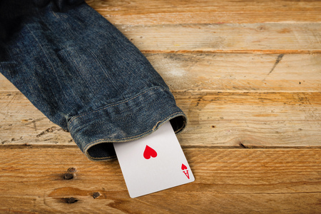 Card up the sleeve, a conceptual shot on cheating and dishonesty Stock Photo