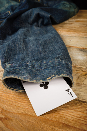 sayings: Card up the sleeve, a conceptual shot on cheating and dishonesty Stock Photo