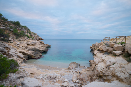 Conill, one of the most popular nudist beaches on Costa Blanca, Spain, amidst scenic rocky landscape Editorial