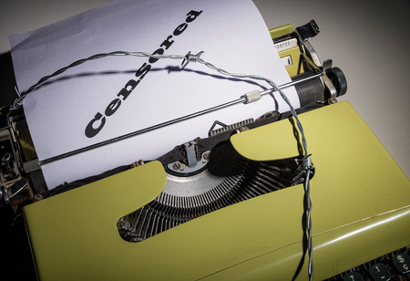 Old typewriter and text as a concept on the ever more threatened freedom of press Stock Photo