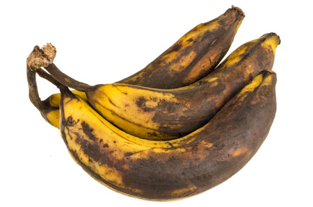 Bunch of over ripe bananas on white background Stock Photo