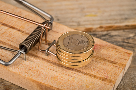 Euro coins on a mouse trap, a financial issues concept Stock Photo